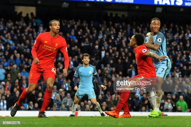 Manchester City's Raheem Sterling and Liverpool's Joel Matip and Nathaniel Clyne in action during the Barclay's Premiership match at the Etihad...