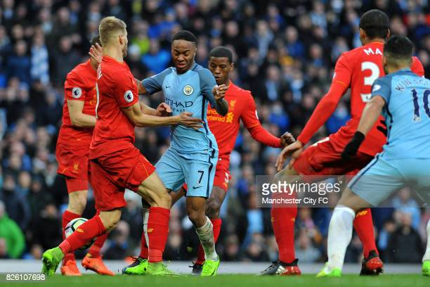 Manchester City's Raheem Sterling and Liverpool's Ragnar Klavan in action during the Barclay's Premiership match at the Etihad Stadium Manchester on...