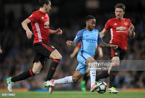 Manchester City's Raheem Sterling and Manchester United's Matteo Darmian battle for the ball