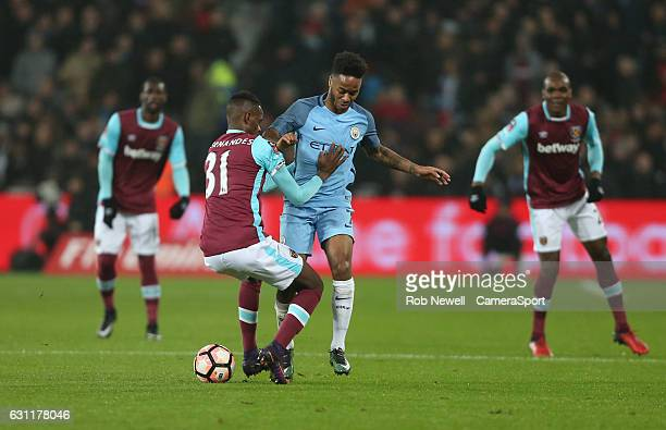 Manchester City's Raheem Sterling and West Ham United's Edimilson Fernandes during the Emirates FA Cup Third Round match between West Ham United and...