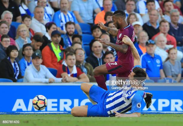 Manchester City's Raheem Sterling Brighton Hove Albion's Lewis Dunk battle for the ball during the Premier League match at the AMEX Stadium Brighton