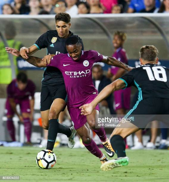 Manchester City's Raheem Sterling fights for the ball against Real Madrid's Vallejo and Marcos Llorente during the International Champions Cup...