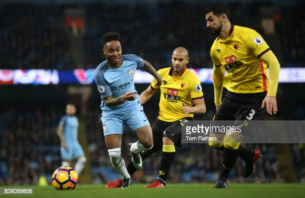 Manchester City's Raheem Sterling in action against Watford's Miguel Britos