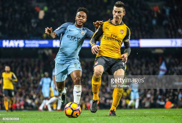 Manchester City's Raheem Sterling in action with Arsenal's Laurent Koscielny