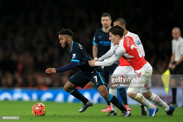 Manchester City's Raheem Sterling looks to get away from Arsenal's Hector Bellerin and Theo Walcott