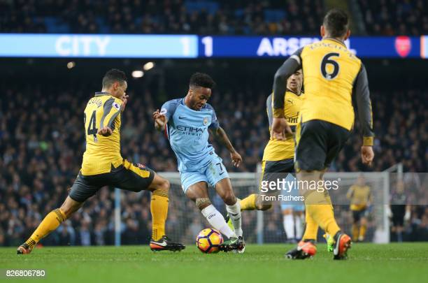 Manchester City's Raheem Sterling takes on Arsenal's Francis Coquelin