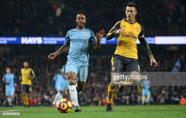 Manchester City's Raheem Sterling takes on Arsenal's Laurent Koscielny