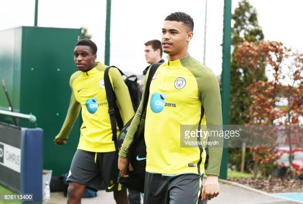 Manchester City's Rodney Kongolo and Cameron Humphreys Grant walking to training