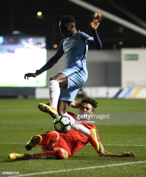 Manchester City's Rodney Kongolo is challeneged by Liverpool's Tiago Lori