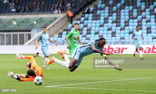 Manchester City's Rodney Kongolo is fouled for a penalty by Borussia Monchengladbach's Franz Langhoff