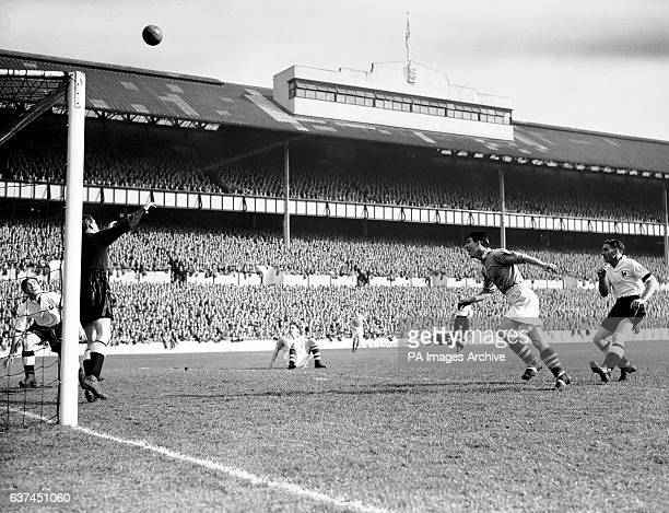 Manchester City's Roy Clarke heads over the bar watched by Tottenham Hotspur's Bill Nicholson Alf Ramsey and Ted Ditchburn