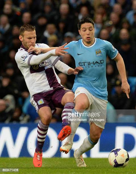 Manchester City's Samir Nasri battles for the ball with Aston Villa's Andreas Weimann during the Barclays Premier League match at the Etihad Stadium...