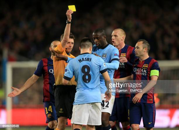 Manchester City's Samir Nasri is shown the yellow card by referee Gianluca Rocchi