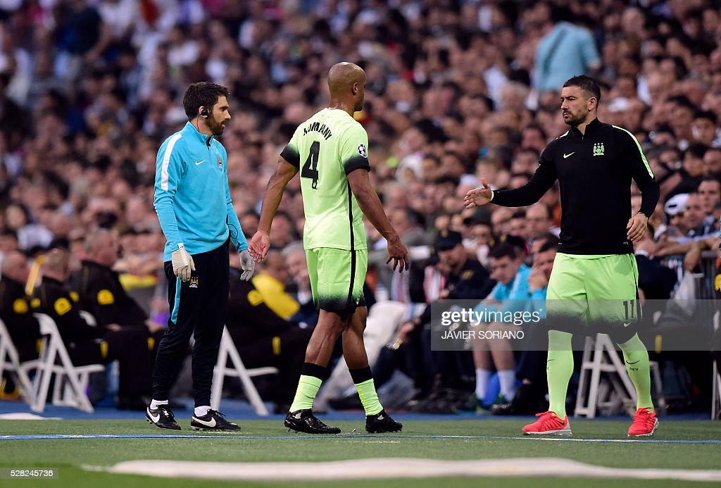Manchester City's Serbian defender Aleksandar Kolarov (R) goes to greet Manchester City's Belgian defender Vincent Kompany (C) as he leaves the pitch during the UEFA Champions League semi-final second leg football match Real Madrid CF vs Manchester City FC at the Santiago Bernabeu stadium in Madrid, on May 4, 2016. / AFP / JAVIER
