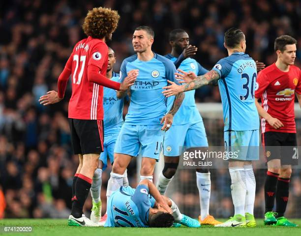 Manchester City's Serbian defender Aleksandar Kolarov reacts after Manchester City's Argentinian striker Sergio Aguero went down in an altercation...