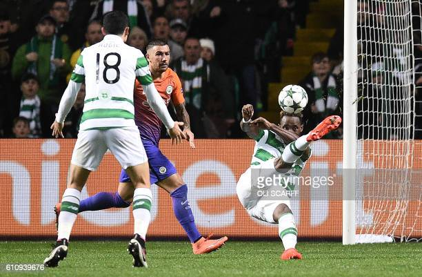 Manchester City's Serbian defender Aleksandar Kolarov watches as Celtic's French striker Moussa Dembele scores his team's thrid goal during the UEFA...