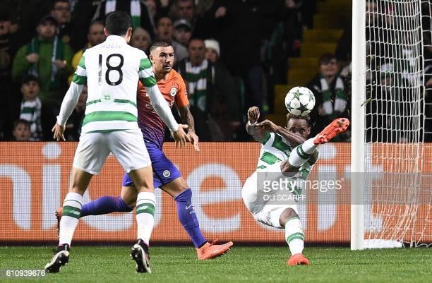 Manchester City's Serbian defender Aleksandar Kolarov watches as Celtic's French striker Moussa Dembele scores his team's thrid goal during the UEFA...