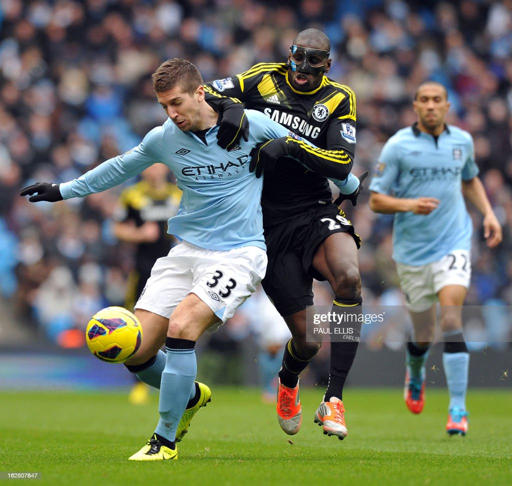 "Manchester City's Serbian defender Matija Nastasic (L) vies with Chelsea's French-born Senegalese striker Demba Ba (R) during the English Premier League football match between Manchester City and Chelsea at the Etihad Stadium in Manchester, northwest England, on February 24, 2013. USE. No use with unauthorized audio, video, data, fixture lists, club/league logos or ""live"" services. Online in-match use limited to 45 images, no video emulation. No use in betting, games or single club/league/player publications."