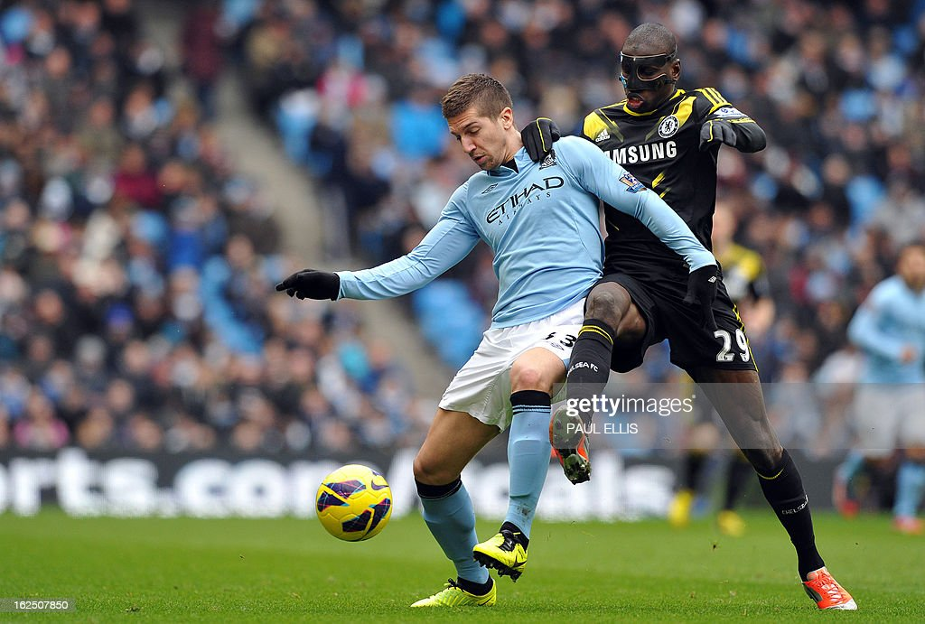 "Manchester City's Serbian defender Matija Nastasic (L) vies with Chelsea's French-born Senegalese striker Demba Ba (R) during the English Premier League football match between Manchester City and Chelsea at the Etihad Stadium in Manchester, northwest England, on February 24, 2013. AFP PHOTO/PAUL ELLIS USE. No use with unauthorized audio, video, data, fixture lists, club/league logos or ""live"" services. Online in-match use limited to 45 images, no video emulation. No use in betting, games or single club/league/player publications."