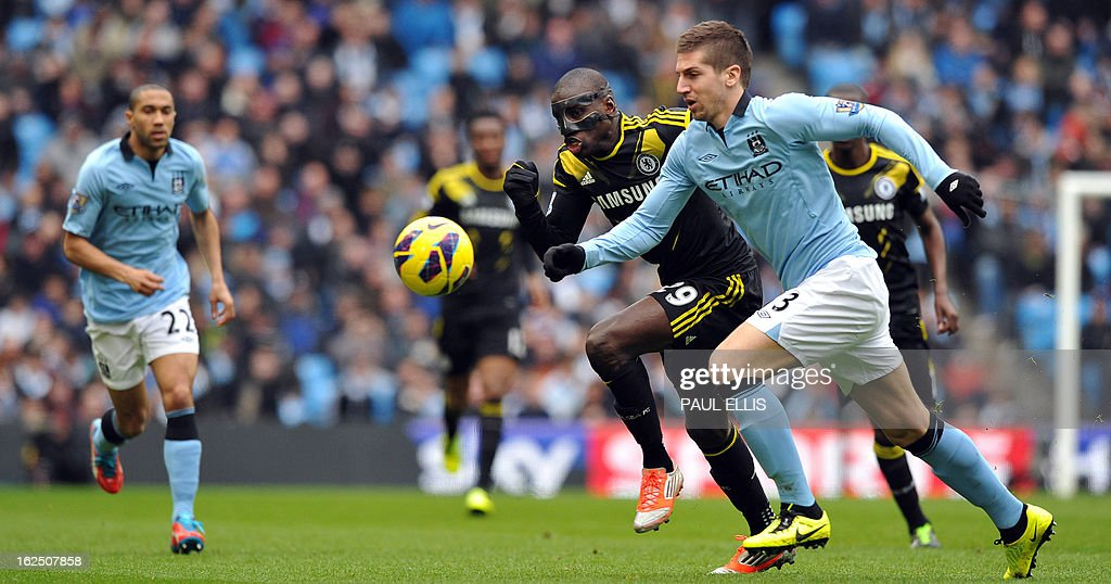 """Manchester City's Serbian defender Matija Nastasic (R) vies with Chelsea's French-born Senegalese striker Demba Ba (2nd R) during the English Premier League football match between Manchester City and Chelsea at the Etihad Stadium in Manchester, northwest England, on February 24, 2013. AFP PHOTO/PAUL ELLIS USE. No use with unauthorized audio, video, data, fixture lists, club/league logos or """"live"""" services. Online in-match use limited to 45 images, no video emulation. No use in betting, games or single club/league/player publications."""