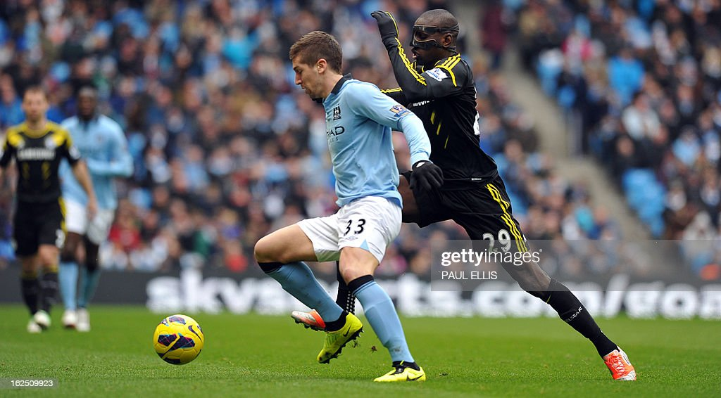 """Manchester City's Serbian defender Matija Nastasic (L) vies with Chelsea's French-born Senegalese striker Demba Ba (R) during the English Premier League football match between Manchester City and Chelsea at the Etihad Stadium in Manchester, northwest England, on February 24, 2013. USE. No use with unauthorized audio, video, data, fixture lists, club/league logos or """"live"""" services. Online in-match use limited to 45 images, no video emulation. No use in betting, games or single club/league/player publications."""