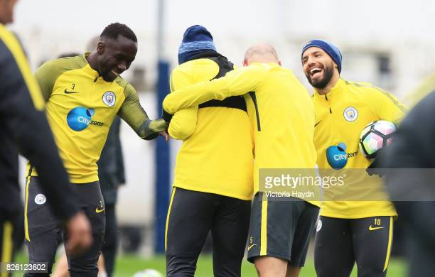 Manchester City's Sergio Ageuro jokes with Bacary Sagna Nicholas otamendi and Pablo Zabaleta