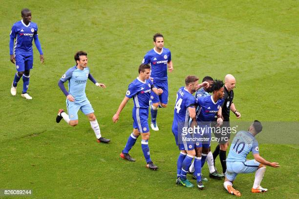 Manchester City's Sergio Aguero and Chelsea's Nathaniel Chalobah in action during the Barclay's Premiership match at the Etihad Stadium Manchester on...