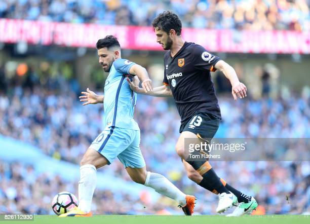 Manchester City's Sergio Aguero and Hull City's Andrea Ranocchia battle for the ball