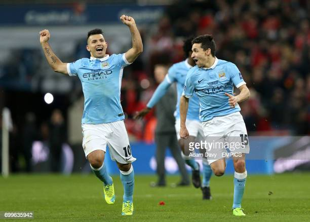 Manchester City's Sergio Aguero and Jesus Navas celebrate after the game
