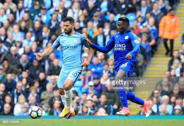 Manchester City's Sergio Aguero and Leicester City's Wilfred Ndidi battle for the ball