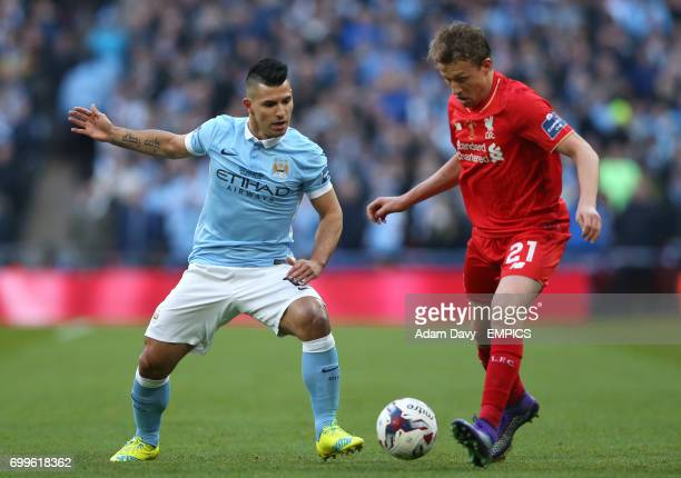 Manchester City's Sergio Aguero and Liverpool's Lucas Leiva battle for the ball