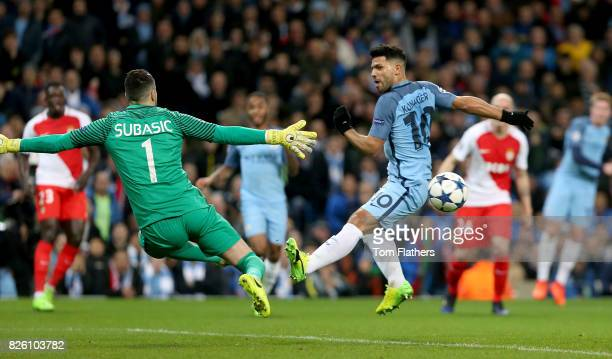Manchester City's Sergio Aguero and Monaco's Danijel Subasic battle for the ball