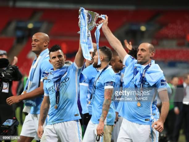 Manchester City's Sergio Aguero and Pablo Zabaleta celebrate victory