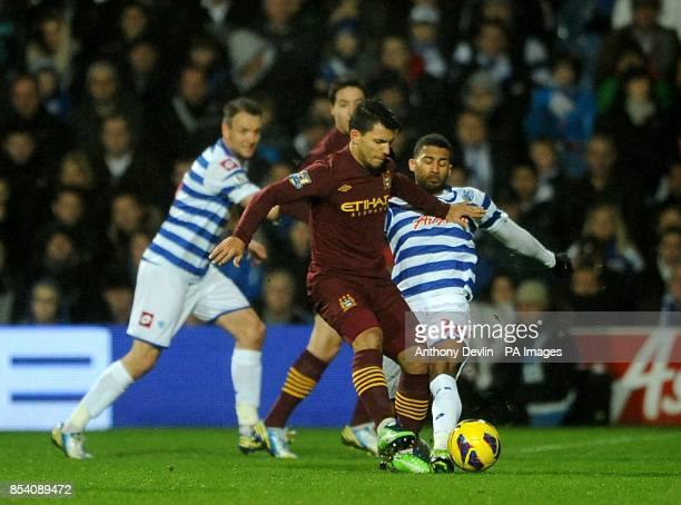 Manchester City's Sergio Aguero and Queens Park Rangers' Armand Traore battle for the ball