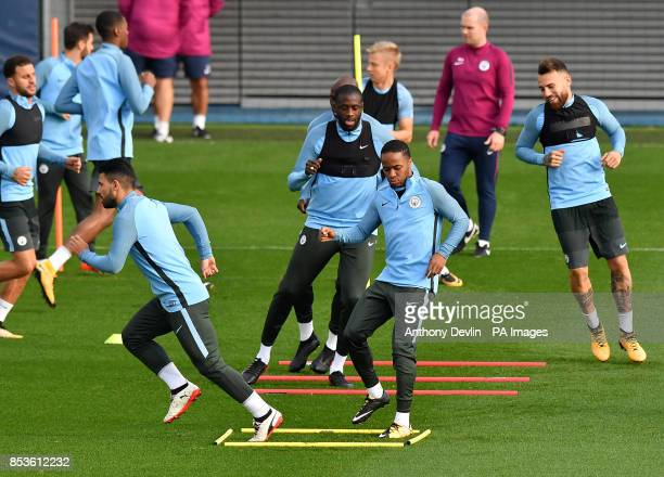 Manchester City's Sergio Aguero and Raheem Sterling during the training session at the CFA Manchester