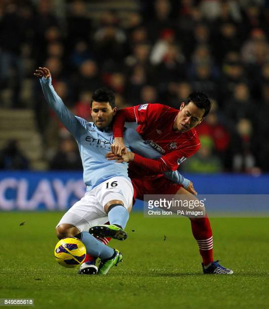 Manchester City's Sergio Aguero and Southampton's Maya Yoshida battle for the ball
