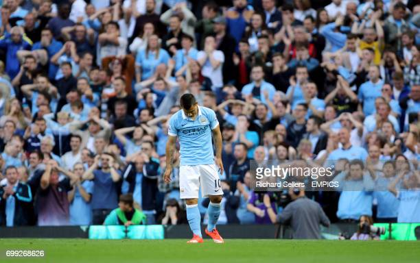 Manchester City's Sergio Aguero and the fans react to a missed chance
