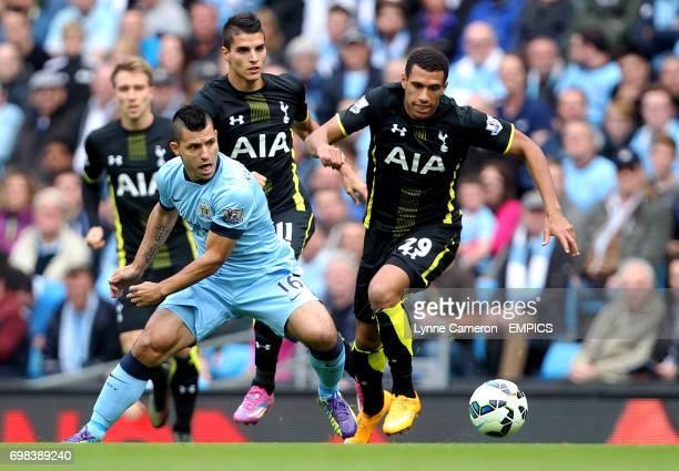 Manchester City's Sergio Aguero and Tottenham Hotspur's Etienne Capoue