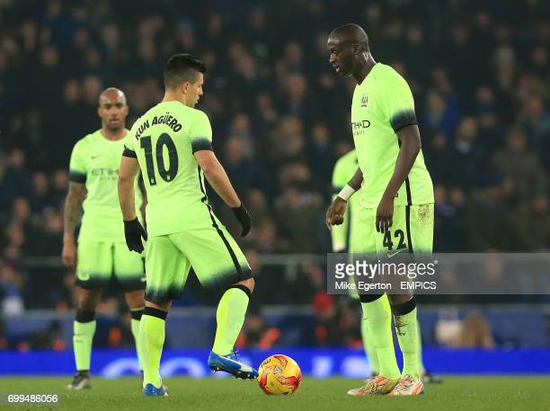 Manchester City's Sergio Aguero and Yaya Toure prepare to kickoff after Everton's Ramiro Funes Mori scores the first goal
