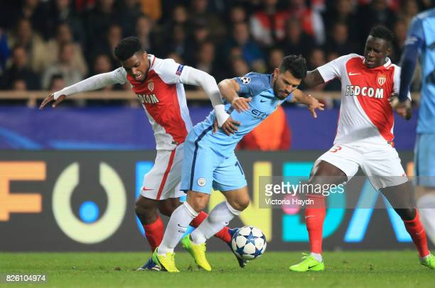 Manchester City's Sergio Aguero battles with AS Monaco's Jemerson and Benjamin Mendy