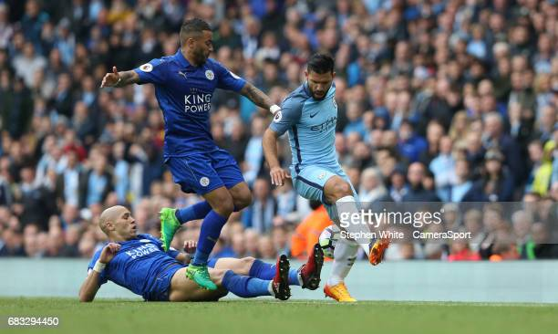 Manchester City's Sergio Aguero battles with Leicester City's Danny Simpson and Yohan Benalouane during the Premier League match between Manchester...