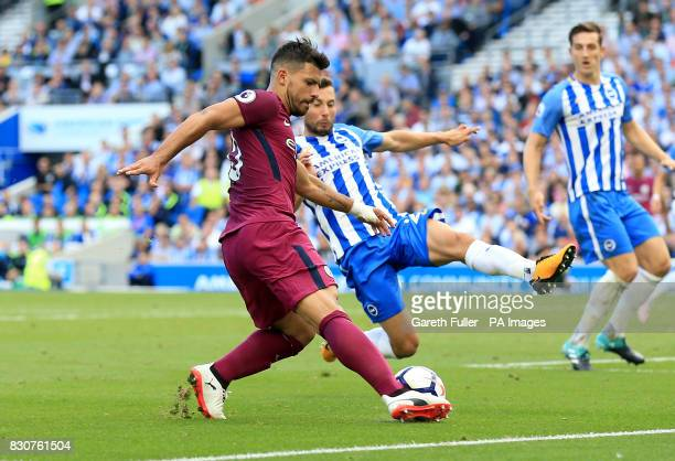 Manchester City's Sergio Aguero Brighton Hove Albion's Markus Suttner battle for the ball during the Premier League match at the AMEX Stadium Brighton