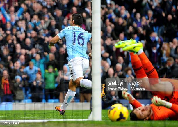 Manchester City's Sergio Aguero celebrates after teammate Gonzalez Jesus Navas scores their first goal as Tottenham Hotspur goalkeeper Hugo Lloris...