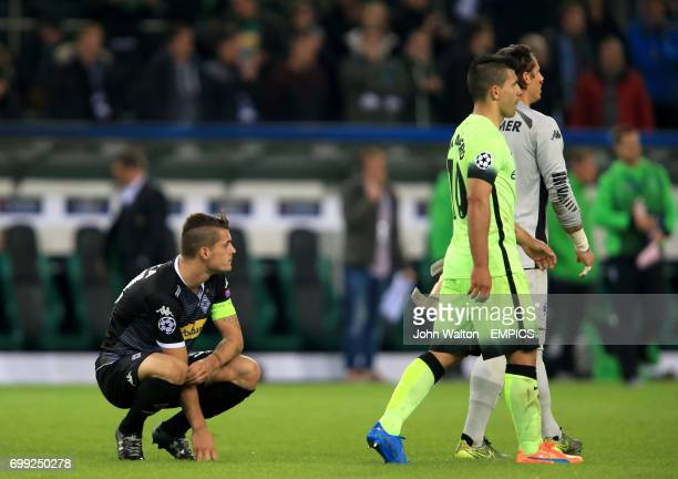 Manchester City's Sergio Aguero celebrates after the final whistle as Borussia Monchengladbach's Granit Xhaka crouches dejected