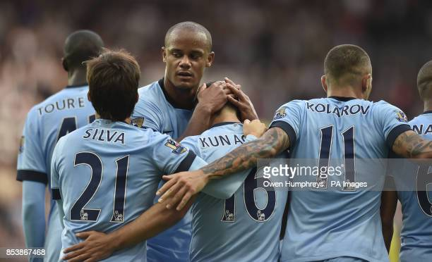 Manchester City's Sergio Aguero celebrates his goal with David Silva Vincent Kompany and Aleksandar Kolarov during the Barclays Premier League match...