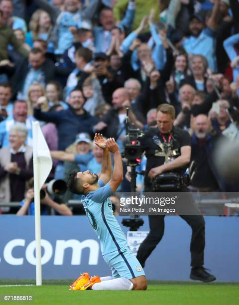 Manchester City's Sergio Aguero celebrates scoring his side's first goal of the game during the Emirates FA Cup Semi Final match at Wembley Stadium...
