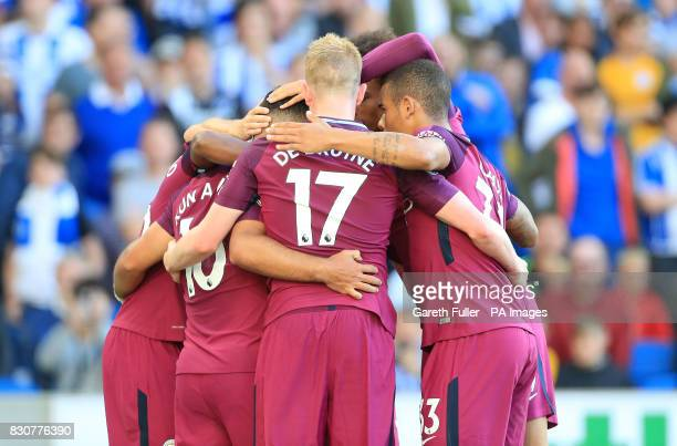 Manchester City's Sergio Aguero celebrates scoring his side's first goal of the game with team mates during the Premier League match at the AMEX...