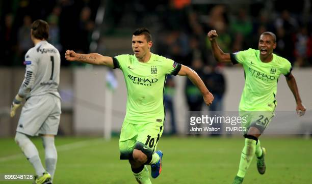 Manchester City's Sergio Aguero celebrates scoring his side's second goal of the game from the penalty spot with teammate Fernandinho