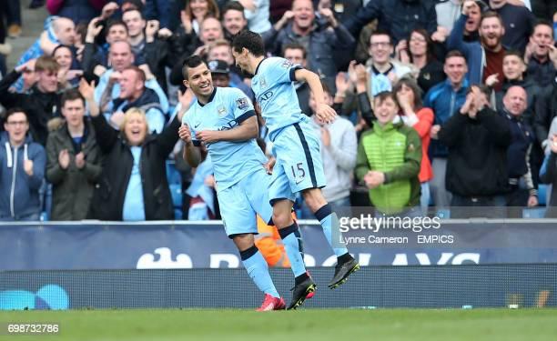 Manchester City's Sergio Aguero celebrates with Jesus Navas