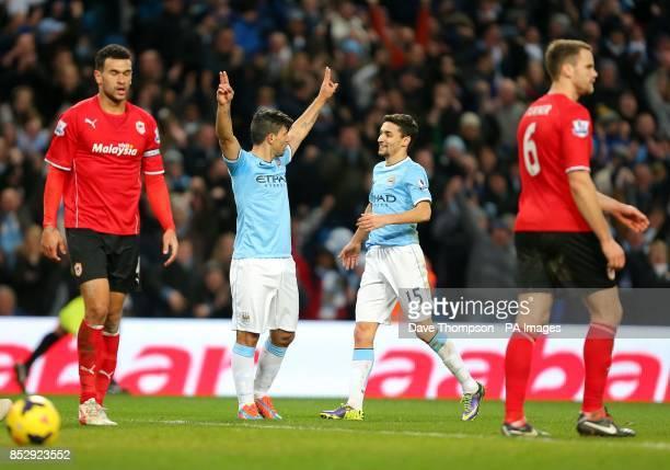 Manchester City's Sergio Aguero celebrates with teammate Jesus Navas after scoring his team's fourth goal